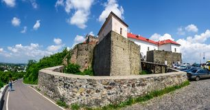 Panorama of Palanok Castle in summertime. Mukachevo, Ukraine - MAY 25, 2008: panorama of Palanok Castle in summertime. Old fortification now serves as the museum Stock Photography