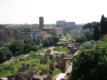 Panorama of the Palatinum of Rome with after all the Coloseum, ruins, antique buildings and an Arc de Triomphe. Italy. Panorama of the Palatinum. Roman antique Royalty Free Stock Photo