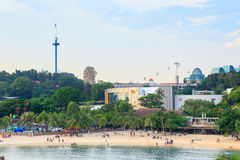 Panorama with Palawan Beach, Palm trees, Merlion, Sky tower and Cable Car on Sentosa Island. Singapore Royalty Free Stock Photo
