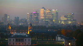 Panorama Panorama of Canary Wharf in night, London. London, UK - October 31, 2015: Panorama Panorama of Canary Wharf in night. View from the Greenwich hills stock footage