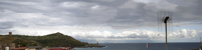 Panorama. Panoramic view of a bay with a cloudy sky royalty free stock images