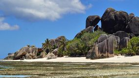 Panorama of the paradisiacal rock formations on the sandy beach royalty free stock photography