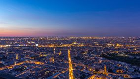 Panorama of Paris after sunset day to night timelapse. Top view from montparnasse building in Paris - France. Panorama of Paris after sunset day to night stock video footage