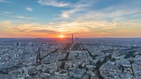 Panorama of Paris at sunset timelapse. Eiffel tower view from montparnasse building in Paris - France stock video footage