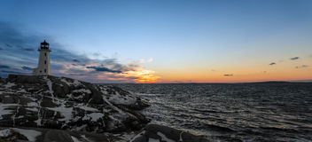 Panorama of Peggys Cove's Lighthouse after Sunset Stock Photography