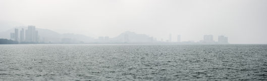 Panorama of Penang Coastline and Skyline from Across the Strait Royalty Free Stock Images