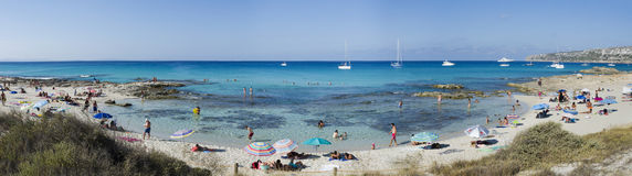Panorama People on vacation on the beach in Formentera Stock Images