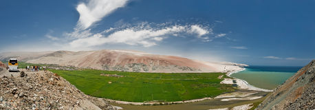 Panorama Peru green valley. Green Valley panorama of Desert Peru between Nazca and Arequipa (with tourists Stock Photo