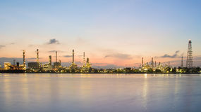 Panorama petrol refinery river front with sunrise sky background Stock Photography