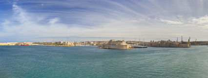 Panorama photo of the Valletta city Grand harbor area at Malta, with many historic buildings along the coastline Stock Photography