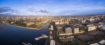 Panorama Photoo of Manila Cityscape in Philippines. Blue Sky and Sunset Light. Pier in Foreground. Business District. Panorama Photoo of Manila Cityscape in Royalty Free Stock Photography