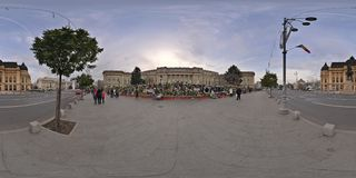 National Mourning after the decease of Michael I at the Royal Palace in Bucharest, Romania. 360 panorama of Piata Revolutiei with Heaps of flowers, candles and Stock Photo