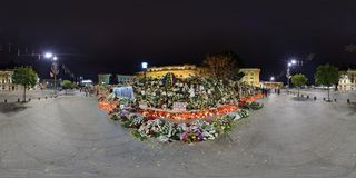 National Mourning after the decease of Michael I at the Royal Palace in Bucharest, Romania. 360 panorama of Piata Revolutiei at night with Heaps of flowers Stock Photo
