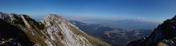Panorama from Piatra Craiului Mountains. Panorama from the south ridge of Piatra Craiului Mountains stock photography