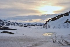 Panorama Picture of the Scandinavian mountains in the north Norway in the spring covered by snow. Royalty Free Stock Photography