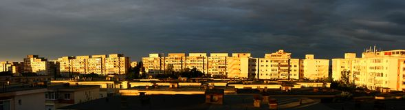 Panorama picture of sunset over blocks Royalty Free Stock Image