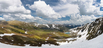 Panorama of a picturesque mountain view. With a small lake and snow made in Altay mountains Royalty Free Stock Images