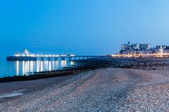 Pier Eastbourne by night, Sussex, United Kingdom. Panorama with pier during the evening in Eastbourne, Sussex, United Kingdom Royalty Free Stock Image