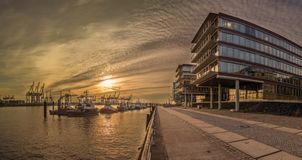 Panorama of a pier in the harbor of Hamburg for tugs royalty free stock photography