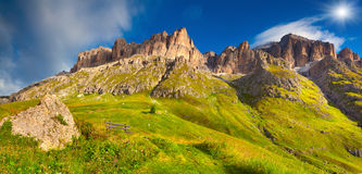 Panorama of the Piz Boe mountain range at sunny foggy morning. V Stock Images