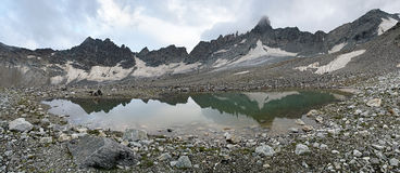 Panorama of plateau with lake near South Belag Pass, Caucasus Stock Photo