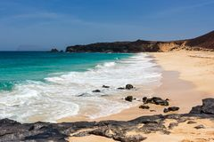 Panorama of Playa de las Conchas beach with blue ocean and white sand. La Graciosa, Lanzarote, Canary Islands, Spain. Panoramic view of Playa de las Conchas royalty free stock images