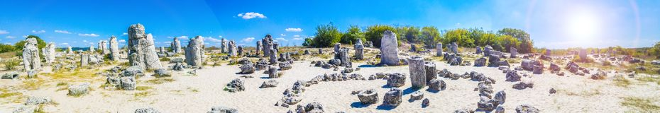 Panorama of Pobiti Kamani, Bulgaria. Pobiti Kamani Bulgarian, `planted stones`, also known as The Stone Desert, is a desert-like rock phenomenon located on the royalty free stock photo