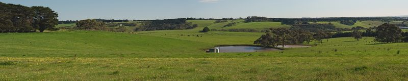 Panorama with pond and hills Royalty Free Stock Images