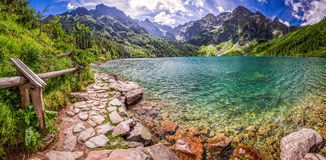 Panorama of pond in the middle of the Tatra mountains Royalty Free Stock Photo