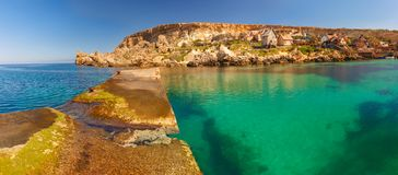 Famous Popeye Village at Anchor Bay, Malta. Panorama of Popeye Village in the sunny day, Malta Royalty Free Stock Photo