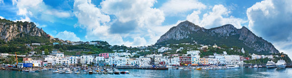 Panorama of the port. CAPRI, ITALY - OCTOBER 3, 2012: Panorama of Marina Grande with its fishing boats, colorful villas, numerous cafes and souvenir shops and Stock Images