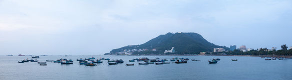 Panorama of port city with mountains and fishing boats Royalty Free Stock Images