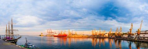 Panorama of the port cranes ships. Beautiful evening at the sea. Sailboat Stock Photo