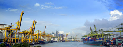 Panorama of the port of Singapore. Panoramic view of the water and port of Singapore with multiple container lifts stock photo