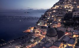 Panorama of Positano by night royalty free stock photography