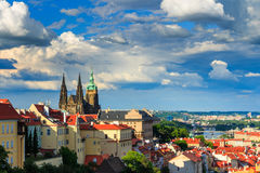 Panorama of Prague from Petrin gardens, Castle and St. Vitus cathedral visible of the left, bridges Stock Photo