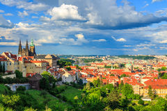 Panorama of Prague from Petrin gardens, Castle and St. Vitus cathedral visible of the left, bridges and Vltava river in the backgr Stock Photo