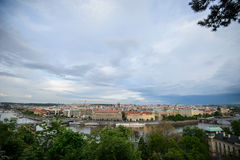 Panorama of Prague with Red Roofs from Above Summer Day at Dusk Stock Photo