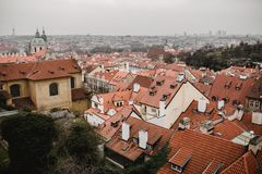 Panorama of Prague with red roofs and Church. City view of Praha old city. Rustic grey colors toning stock photo