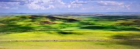 Panorama prairie and mountains landsacpe. Beautiful panorama prairie and mountains landsacpe, China Royalty Free Stock Photo