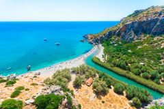 Panorama of Preveli beach at Libyan sea, river and palm forest, southern Crete. Royalty Free Stock Photo