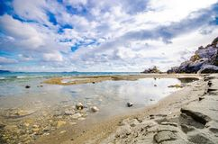 Panorama of Preveli beach at Libyan sea, river and palm forest, southern Crete. Stock Photos