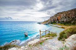 Panorama of Preveli beach at Libyan sea, river and palm forest, southern Crete. Stock Photography