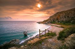Panorama of Preveli beach at Libyan sea, river and palm forest, southern Crete. Royalty Free Stock Photos