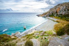 Panorama of Preveli beach at Libyan sea, river and palm forest, southern Crete. Royalty Free Stock Images