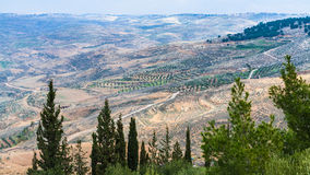 Panorama Promised Land from Mount Nebo in winter. Travel to Middle East country Kingdom of Jordan - panorama of Promised Land from Mount Nebo in winter Royalty Free Stock Image