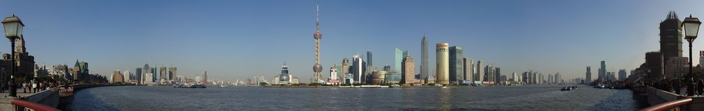 Panorama of Pudong Seen From Shanghai, China. Panoramic view of the Huangpu river and Pudong, China as seen from The Bund in Shanghai, China Royalty Free Stock Image