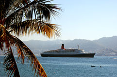 Panorama of Queen Elizabeth 2 cruise ship visit to Acapulco, Mexico during World Cruise in 2006. Royalty Free Stock Image