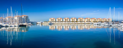 Panorama of Queensway Quay Marina, Gibraltar. Showing luxury apartments and yachts moored in the marina royalty free stock photography