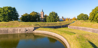 Panorama of rampart and church of Naarden, Netherlands. Panorama of Big Church and rampart with bastion Promers in old fortified town of Naarden, North Holland Stock Photo